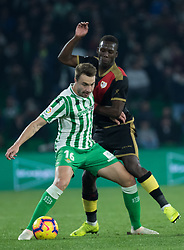 December 9, 2018 - Seville, Andalucía, Spain - Loren, Real Betis, and Imbula, Rayo, fight for the ball during the LaLiga match between Real Betis and Rayo in Benito Villamarín Stadium  (Credit Image: © Javier MontañO/Pacific Press via ZUMA Wire)