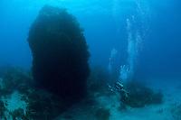 """Divers navigate """"Thumb Rock""""..Shot in British Virgin Islands"""