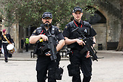 Armed police officers from the City of London Police force patrol at the Tower of London  in London, England on September 05, 2018.
