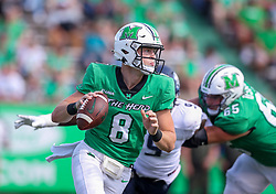 Oct 9, 2021; Huntington, West Virginia, USA; Marshall Thundering Herd quarterback Grant Wells (8) looks to pass during the first quarter against the Old Dominion Monarchs at Joan C. Edwards Stadium. Mandatory Credit: Ben Queen-USA TODAY Sports