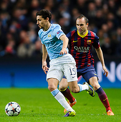 Man City Midfielder Jesus Navas (ESP) vb Barcelona Midfielder Andres Iniesta (ESP) - Photo mandatory by-line: Rogan Thomson/JMP - Tel: 07966 386802 - 18/02/2014 - SPORT - FOOTBALL - Etihad Stadium, Manchester - Manchester City v Barcelona - UEFA Champions League, Round of 16, First leg.