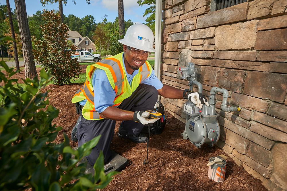 Piedmont Natural Gas Service Technician Installing Gas Meter