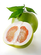 Fresh Pomelo grapefruit whole and cut with leaves