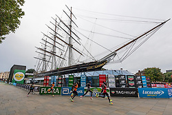 © Licensed to London News Pictures. 03/10/2021. London, UK. Elite men runners run past the Cutty Sark during the London Marathon 2021. Photo credit: Ray Tang/LNP