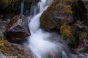 Water splashes and twists as it maneuvers rocks in Killen Creek.