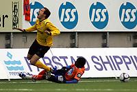 Fotball , 19 april 2009<br /> Tippeligaen<br /> Aalesund - start 1 - 1<br /> <br /> Glenn roberts - aalesund<br /> hunter freeman - start<br /> <br /> Foto: Richard Brevik , Digitalsport
