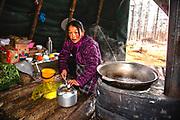 Tsaatan women making traditional salt tea in the morning, Khovsgol Province, Mongolia