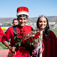 Lorenzo Sanchez, 15, standing in for his older brother Adrian Sanchez, and Ashton Baros, 18, crowned Homecoming King and Queen during halftime in their game against the Shiprock Chieftains.  Adrian Sanchez is currently in the hospital recovering from a football injury.
