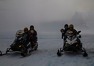 10-month-old and 4-year-old snowmobiling in national park in Iceland. Read more at: https://www.cntraveler.com/story/why-adventure-travel-is-for-the-whole-family