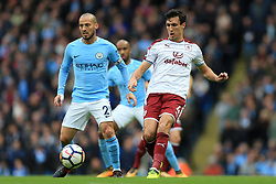 21st October 2017 - Premier League - Manchester City v Burnley - Jack Cork of Burnley battles with David Silva of Man City - Photo: Simon Stacpoole / Offside.