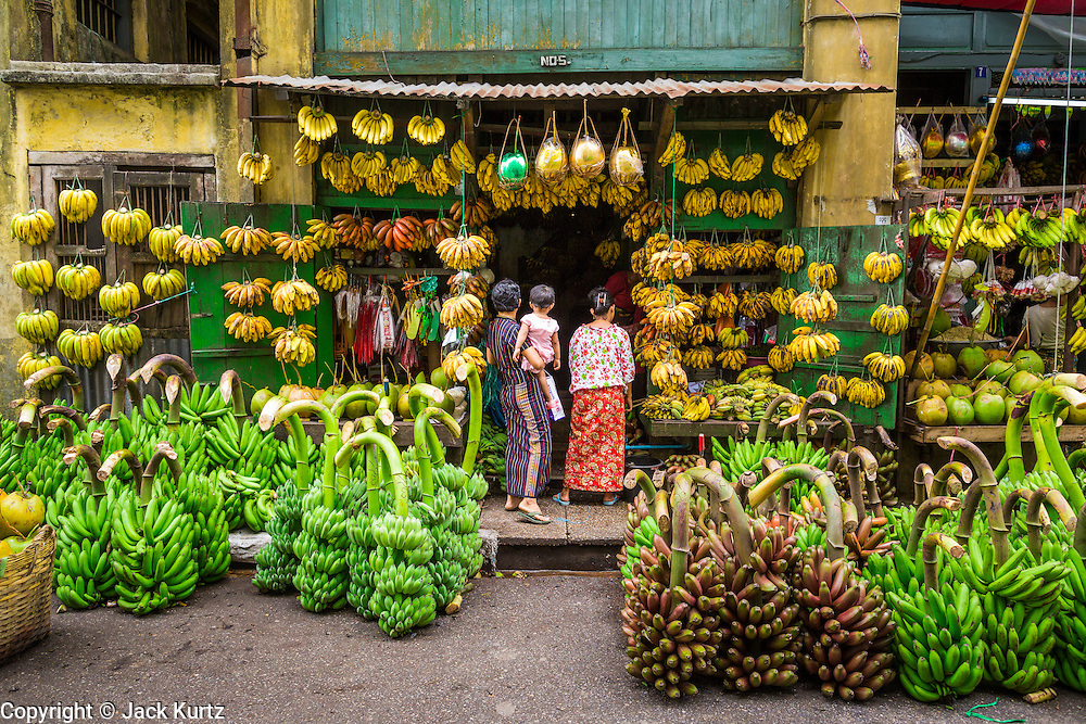 08 JUNE 2014 - YANGON, MYANMAR: A banana shop in a colonial building built in 1928 on Strand Road in Yangon. Yangon has the highest concentration of colonial style buildings still standing in Asia. Efforts are being made to preserve the buildings but many are in poor condition and not salvageable.   PHOTO BY JACK KURTZ