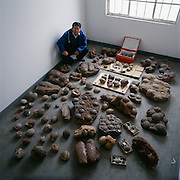 Paleontologist Dong Zhiming with about 175 dinosaur eggs of varying species confiscated and brought to the Institute of Cultural Relics.  Authorities confiscated some 3000 eggs in 1993.