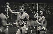 """Paris,1955.  Tony Curtis, Burt Lancaster, Gina Lollobrigida, waiting for the Director Carol Reed to tell them what the scene is about for the film TRAPEZE shot in """"Le Cirque d'Hiver"""" <br /> Burt Lancaster, as a young man, actually worked in a circus!<br /> <br /> Paris, 1955 . Tournage du  film TRAPEZE au """"Cirque d'Hiver """".Tony Curtis, Burt Lancaster et  Gina Lollobrigida attendant que le directeur Carol Reed leur donnes les instructions de la prochaine scène. <br /> Burt Lancaster, jeune homme, avait effectivement travaillé dans un cirque!"""