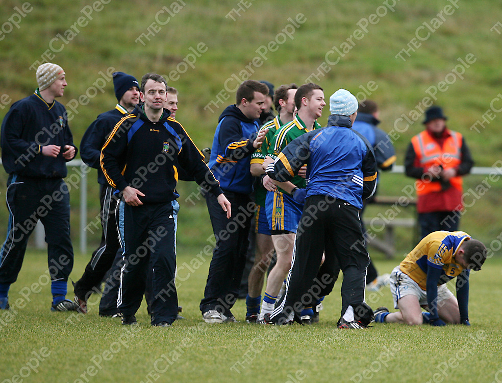 Spa celebrate as Cratloe's Martin Oige Murphy drops to his knees in disappointment after the Munster Intermediate Football Championship Final in Mallow on Sunday.<br /> Photograph by Yvonne Vaughan