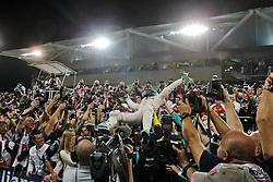 Grand Prix von Abu Dhabi auf dem Yas Marina Circuit / 271116<br /> <br /> ***Nico Rosberg (GER) Mercedes AMG F1 celebrates his World Championship in parc ferme with the team and wife Vivian Rosberg (GER).<br /> 27.11.2016. Formula 1 World Championship, Rd 21, Abu Dhabi Grand Prix, Yas Marina Circuit, Abu Dhabi, Race Day.<br /> ***