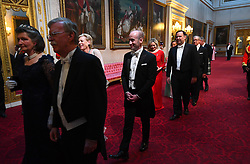 The Countess Peel and Stephen Miller arrive through the East Gallery during the State Banquet at Buckingham Palace, London, on day one of the US President's three day state visit to the UK.