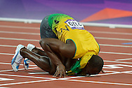 Jamaica's Usain Bolt kisses the finish line after winning a Gold Medal in the Men's 200M Final at the London 2012 Summer Olympics on August 9, 2012 in Stratford, London. Bolt won a Gold Medal with a time of 19.32 seconds in the final.  (UPI)