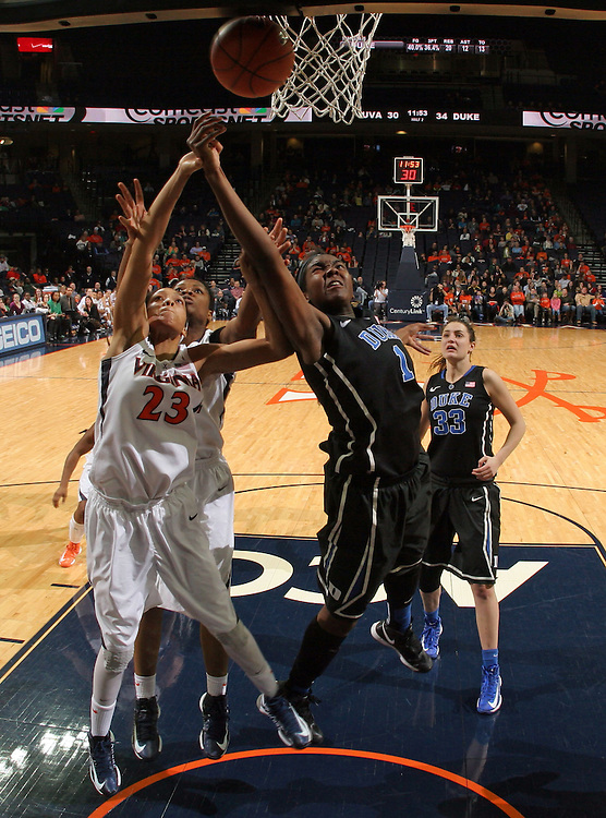 Duke center Elizabeth Williams (1) reaches for the rebound with Virginia guard Ataira Franklin (23) during an NCAA college basketball game in Charlottesville, Va. Duke defeated Virginia 62-41...