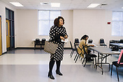 """SELMA, AL – DECEMBER 19, 2019: Keshee Dozier-Smith, 34, accepts a nomination for Finance Chair before leaving a YMCA Board of Directors meeting. Dozier-Smith took her seat on the Selma-Dallas County YMCA Board of Directors in September, 2019, and views her involvement there as an opportunity to encourage overall fitness and wellness within the community, and within the Rural Health Medical Program network. """"It's really part of our broader mission at Rural Health Medical Program – helping our patients connect with the community through health, fitness and wellness, and to bring people from different walks of life together."""" <br /> <br /> Since joining Rural Health Medical Program as Chief Executive Officer in March 2016, Dozier-Smith has effectively moderned the 35-year-old floundering business – opening three new clinics, streamlining processes and reaching out to local companies to offer healthcare services for employees. In the wake of rising hospital closures that leave Alabama's poorest citizens disproportionately cut off from access to medical care, Dozier-Smith represents a renewed effort to bridge the rural gap by offering a quality, affordable healthcare option."""