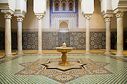 Courtyard decorated with mosaics and a marble fountain inside the Mausoleum of Moulay Ismail in Meknes, Morocco on November 1, 2007.