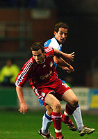 Photo: Paul Greenwood.<br />Wigan Athletic v Liverpool. The Barclays Premiership. 02/12/2006. Liverpool's Steve Finnan, left, shields the ball from Wigan's David Wright