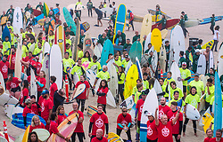 June 20, 2017 - Huntington Beach, California, USA - Nearly 600 surfers wait on the beach to go into the water just north of the Huntington Beach Pier in Huntington Beach just prior to creating the world's largest paddle out ''Surfing Circle of Honor'' in Huntington Beach Tuesday morning, June  20, 2017. (Photo by Mark Rightmire, Orange County Register/SCNG) (Credit Image: © Mark Rightmire, Mark Rightmire/The Orange County Register via ZUMA Wire)