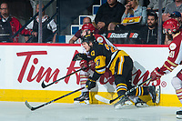 REGINA, SK - MAY 22:  Robert Thomas #27 of Hamilton Bulldogs checks a player of the Acadie-Bathurst Titan into the boards at Brandt Centre - Evraz Place on May 22, 2018 in Regina, Canada. (Photo by Marissa Baecker/Getty Images)