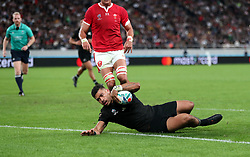 New Zealand's Richie Mo'unga scores his sides sixth try during the 2019 Rugby World Cup bronze final match at Tokyo Stadium.