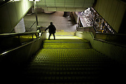 TOKYO, JAPAN - 24 MARCH - A man drunk get donw the stair catching the bannister - March 2012
