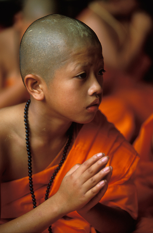 A novice monk just after he has been ordained at Poy Sang Long, the yearly ordination ceremonies in Mae Hong Son, Thailand. April 2003.