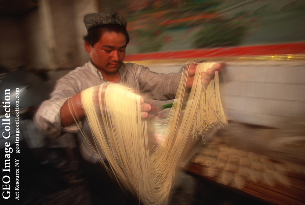 A chef makes Tiao zi, literally 'pulled strings,' that are made only by hand. <br /> Xinjiang, China
