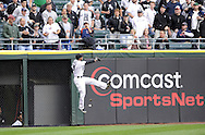 CHICAGO - SEPTEMBER 29:  DeWayne Wise #31 of the Chicago White Sox leaps but cannot make the catch at the wall during the game against the Detroit Tigers at U.S. Cellular Field in Chicago, Illinois on September 29, 2008.  The White Sox defeated the Tigers 8-2.  (Photo by Ron Vesely)