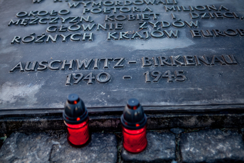 Candles laid down at a memorial stone at the Auschwitz Birkenau Nazi concentration camp. It is estimated that between 1.1 and 1.5 million Jews, Poles, Roma and others were killed in Auschwitz during the Holocaust in between 1940-1945.