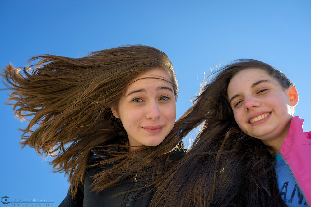 Young teens taking a selfie on a windy beach, Cape May, New Jersey.