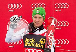Overall winner of Vitranc Cup HIRSCHER Marcel  of Austria celebrates at trophy ceremony after the 10th Men's Slalom - Pokal Vitranc 2013 of FIS Alpine Ski World Cup 2012/2013, on March 10, 2013 in Vitranc, Kranjska Gora, Slovenia. (Photo By Vid Ponikvar / Sportida.com)