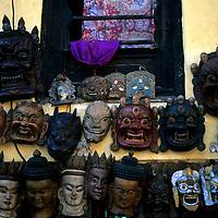 Asia, Nepal, Kathmandu, Bhaktapur. Traiditonal wooden nepalese masks for sale in Bhaktapur near Kathmandu.