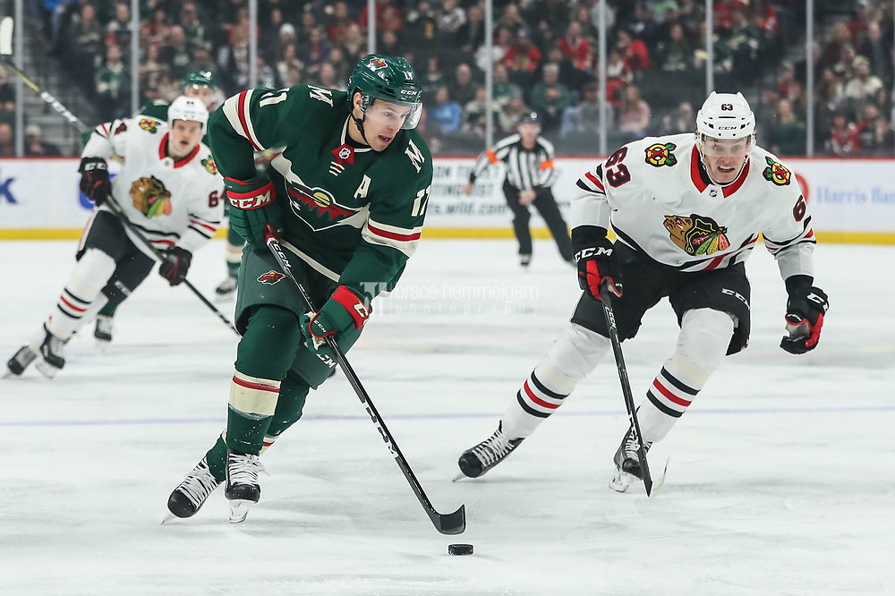 Feb 10, 2018; Saint Paul, MN, USA; Minnesota Wild forward Zach Parise (11) carries the puck during the first period against the Chicago Blackhawks at Xcel Energy Center. Mandatory Credit: Brace Hemmelgarn-USA TODAY Sports