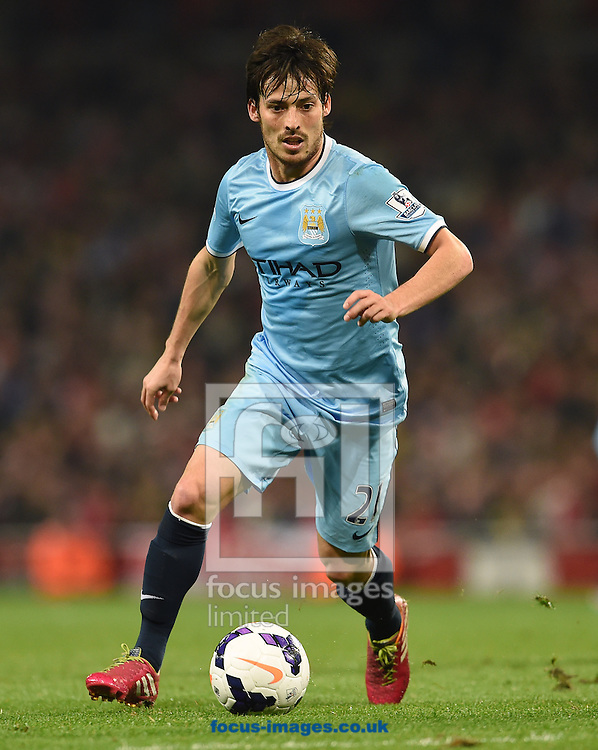 David Silva of Manchester City during the Barclays Premier League match against Arsenal at the Emirates Stadium, London<br /> Picture by Andrew Timms/Focus Images Ltd +44 7917 236526<br /> 29/03/2014