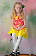 Easter outfit on a young girl with colorful background.