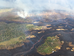 Handout photo taken on May 22, 2018 of Kilauea Volcano — Overflight of Lower East Rift Zone. View during an early morning overflight of KÄ«lauea Volcano's lower East Rift Zone. Two fissures (not pictured) are sending lava down two channels that merge near the coast. Photo by usgs via ABACAPRESS.COM