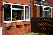 A dog sits in the window of a house on a council estate in Leyland, Lancashire.<br /> (photo by Andrew Aitchison / In pictures via Getty Images)