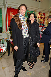 MICHELE CARDONE and ALISON ROSS-GREEN at the London debut of Nest - an organisation to promote peace and prosperity in partnership with artisans worldwide, held at Thomas Goode & Co, South Audley Street, London on 4th November 2014.