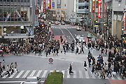 people starting to cross at the Hachiko zebra crossing in Shibuya