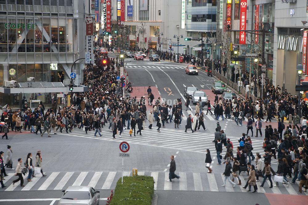 people starting to cross at the Hachiko zebra crossing in Shibuya