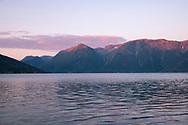 Sunset reflections on Hardanger Fjord, Vestlandet, Norway, Europe