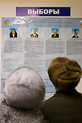 Moscow, Russia, 02/03/2008..Two Russian voters study their choices in the Presidential election that President Vladimir Putin's chosen heir Deputy Prime Minister Dmitry Medvedev is expected to win easily in the first round.