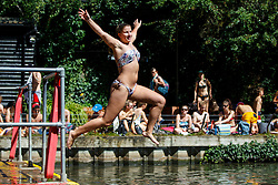 © Licensed to London News Pictures. 23/08/2016. London, UK. Saskia Tholen swims in Hampstead Heath Mixed Bathing Pond in north London as they enjoy August's last heatwave on Tuesday, 23 August 2016. Photo credit: Tolga Akmen/LNP