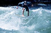 A surfer in Eisbach River, Munich, Germany