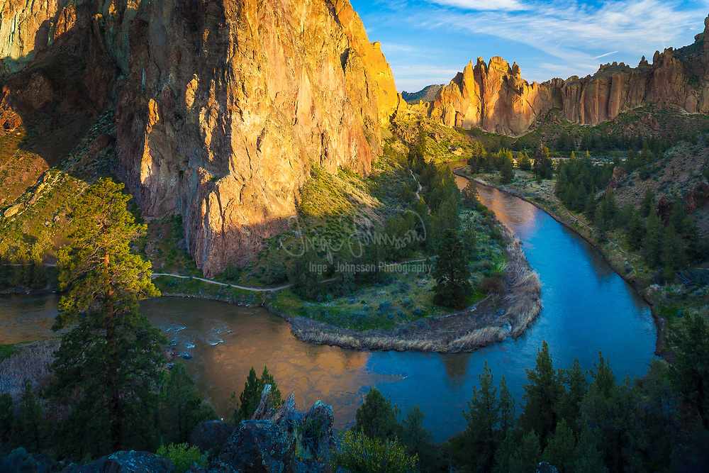 Crooked River and Smith Rock<br /> .....<br /> Smith Rock State Park is an American state park located in central Oregon's high desert near the communities of Redmond and Terrebonne. Its sheer cliffs of tuff and basalt are ideal for rock climbing of all difficulty levels. Smith Rock is generally considered the birthplace of modern American sport climbing, and is host to cutting-edge climbing routes. There is sport climbing, traditional climbing, multi-pitch climbing, and bouldering.<br /> <br /> The park contains the first U.S. climb rated 5.14. The area is well known for its challenging climbing routes so eventually all top climbers visit. In 1983, Allan Watts began to use sport climbing ethics which pushed American climbing to new levels. Shortly after, between 1992 and 2009, about 500 new climbing routes were added. This brought climbers from all over the world as Smith Rock became the world capital for sport climbing. To this day the park still attracts climbers from all over the world. The winter tends to be too cold (below freezing) for climbing and the summer months regularly reach the 100s °F. In addition to the world-famous rock climbing, Smith Rock State Park is host to many miles of hiking trails, the meandering Crooked River and views of the volcanic peaks of Oregon's Cascade Range.