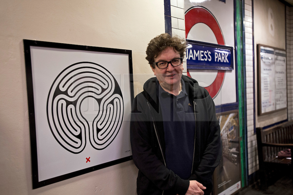 © London News Pictures. 07/02/2013 . London, UK.  Artist Mark Wallinger posing next to one of his artworks on the platform of St James's Park Station, London Underground's largest ever art commission on February 7, 2013. Mark  Wallinger has been commissioned to produce artworks in all 270 stations on the Underground network to celebrate the 150 year anniversary of the tube opening. .Photo credit : Ben Cawthra/LNP
